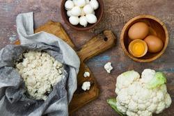 Preparing cauliflower pizza crust.