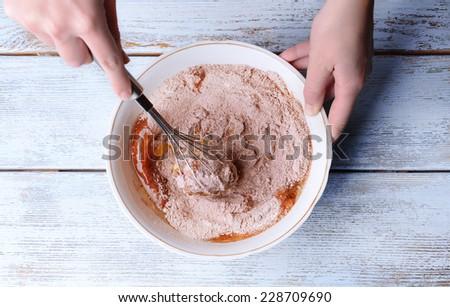 Preparing dough, mixing ingredients