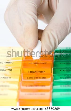 Preparing drugs (medicines) into medication dispenser