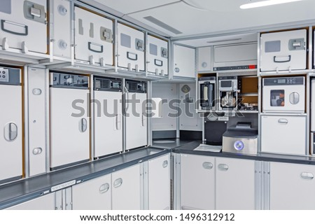Preparing food for the passengers in the empty kitchen corner inside airplane Stockfoto ©
