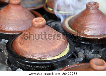 Preparing food in a Tajin Morocco