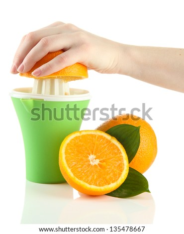 Preparing fresh orange juice squeezed with hand juicer, isolated on white
