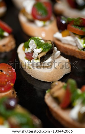 Preparing homemade bruschetta with cheese and vegetables