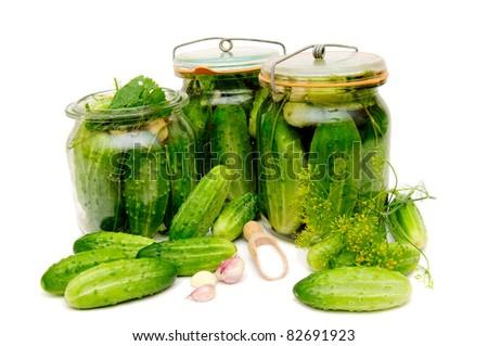 Preparing of pickled cucumbers in jars.