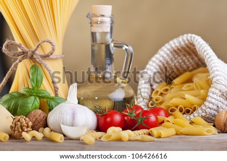 Preparing pasta with assorted ingredients