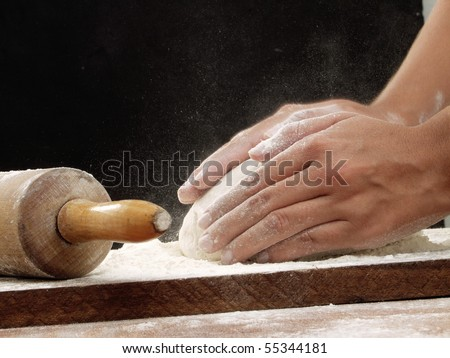 Preparing pizza dough.