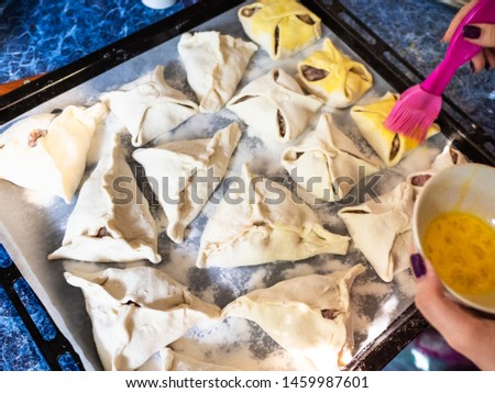 preparing savoury meat pastry Samsa in home kitchen