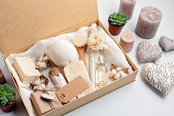 Preparing self care package, seasonal gift box with plastic free zero waste cosmetics products. Personalized eco friendly basket for family and friends for thankgiving, christmas, mothers day
