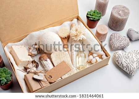 Preparing self care package, seasonal gift box with plastic free zero waste cosmetics products. Personalized eco friendly basket for family and friends for thankgiving, christmas, mothers day   Stock photo ©