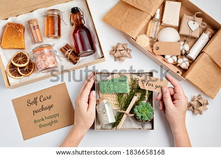Preparing self care package, seasonal gift box with plastic free zero waste cosmetics products. Personalized eco friendly basket for family and friends for christmas, mothers day