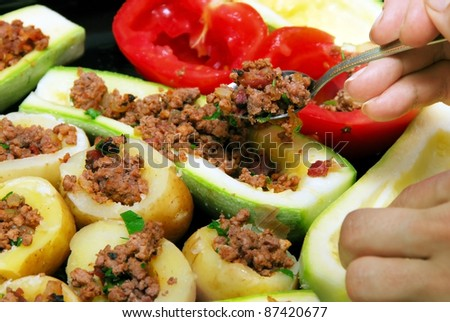 preparing stuffed vegetables with minced meat