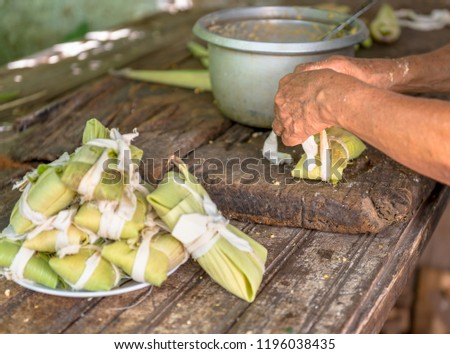Preparing tamales during the day.  The tamal is a traditional Latin American food made of corn dough
