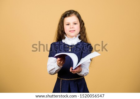 Preparing to exams. hometwork. notebook for diary notes. study lesson. small girl with paper folder. knowledge and education. Back to school. serious small girl wants to be teacher. exam time. #1520056547