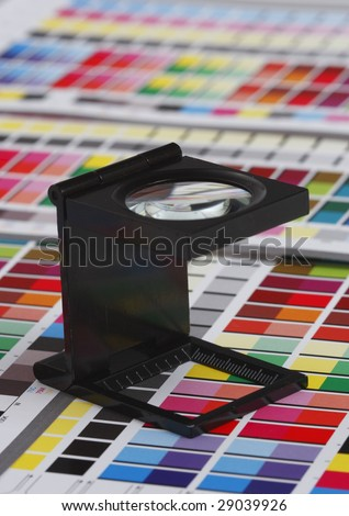Prepress color management in print production. CMYK color check on printed paper. Quality printing concept