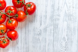 Prepring for cooking dinner. Tomato on wooden table background top view copyspace