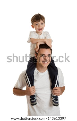 Preschool aged boy riding on teen boy's shoulders isolated on white background