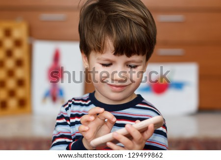 Preschool boy playing on smartphone