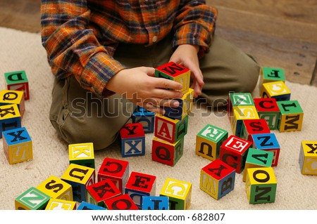 Preschool boy playing with blocks