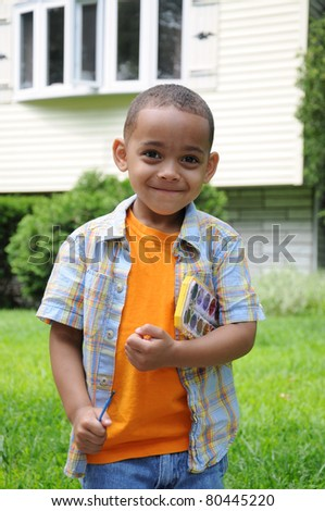 Preschool Boy Smiling Holdng Paint Set and Brush
