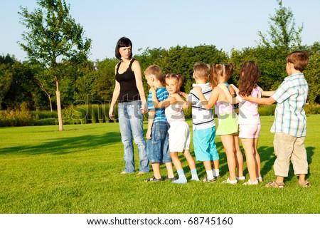 Preschool boys and girls following their teacher