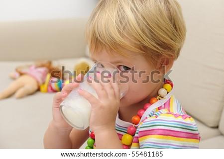 Preschool Child drink glass os milk