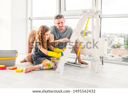 Preschool cute girl help her dad to do cleaning chores at home #1495562432