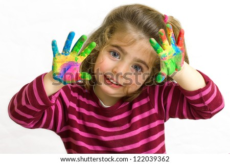 preschool girl with hands in the paint