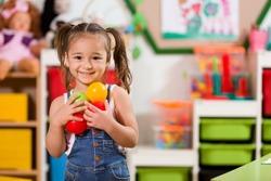 Preschool Student Posing in Classroom