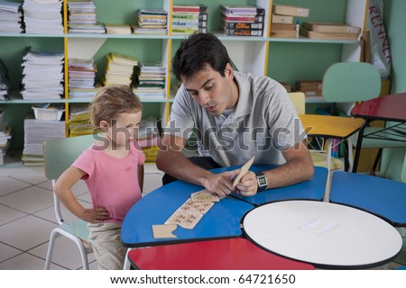 preschool teacher and child in the classroom counting
