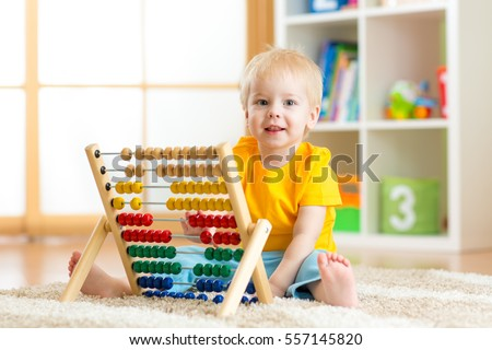 Shutterstock Preschooler baby learns to count. Cute child playing with abacus toy. Little boy having fun indoors at home, kindergarten or day care centre. Educational concept for preschool kids.