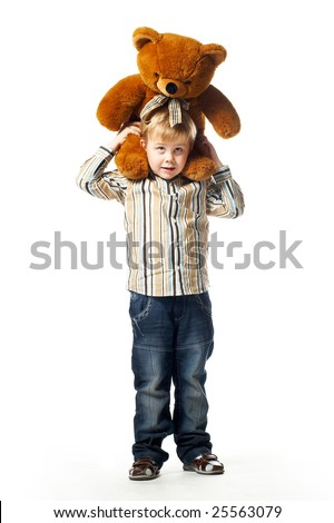 Preschooler boy standing with a teddy bear on his shoulders isolated on white