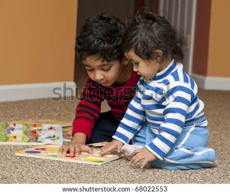 Preschooler showing Baby Sister Number and Shapes Puzzle