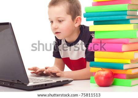 preschooler with lot of books and laptop on floor, isolated on background