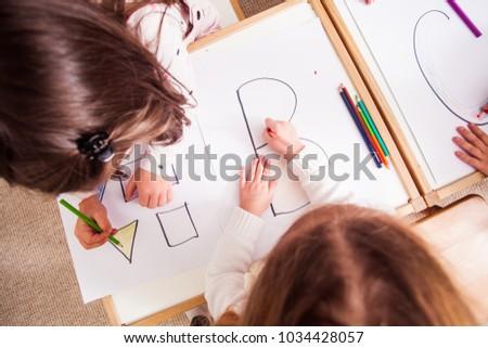 Preschoolers learn letters #1034428057