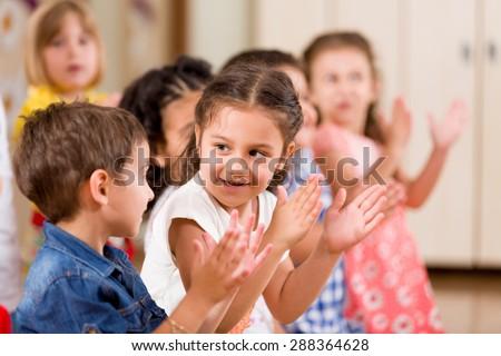 Preschoolers playing in classroom.