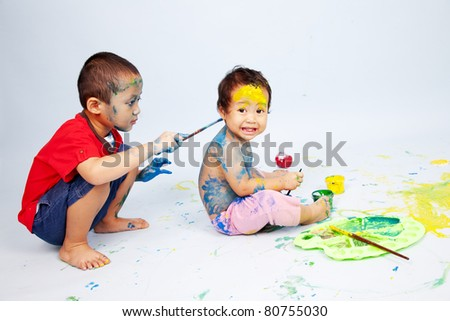 Preschoolers playing with paint
