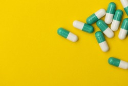 Prescription antibiotic drug medication pills on a bright colourful background. Health care concept
