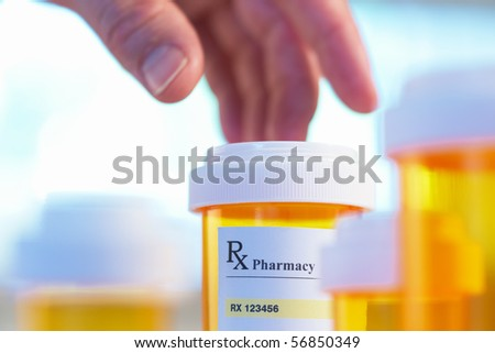 Prescription bottle and hand with motion blur selective focus