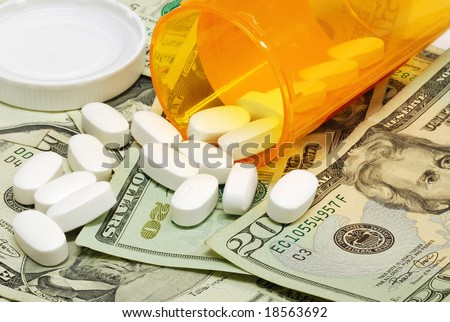 Prescription drugs on a money background representing rising healthcare costs