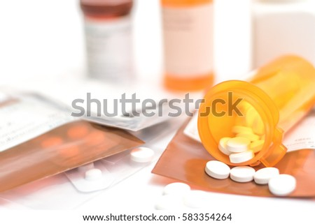 Prescription order from hospital doctor with medicines, drug in plastic zip bags and yellow bottle for chronic patient. Antibiotics , paracetamol, vitamins supplement dosage on white background.