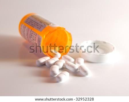 Prescription Pain Pills spilling out of a bottle