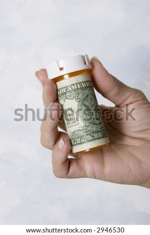Prescription pill bottles wrapped in one dollar bills with copy space for your message