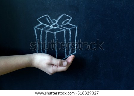 Present and child's hand abstract background concept #518329027