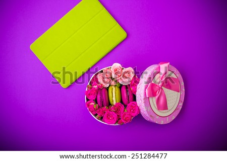 present box with flowers macaroons and tablet violet background for valentines mother day easter with love