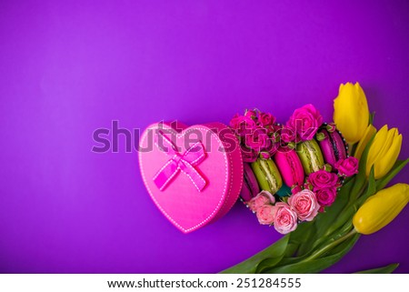 present box with flowers macaroons and tulips violet background for valentines mother day easter with love