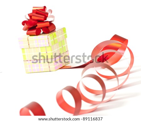 Present box with red ribbon bow isolated on white