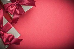 Present boxes on red background close up view holidays concept.