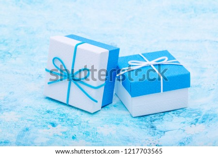 Present. Gift boxes packed with blue bow. Christmas gifts and greetings