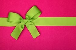 Present with green ribbon bow