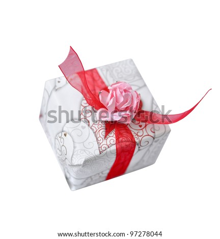 present with red ribbon and pink flower - stock photo